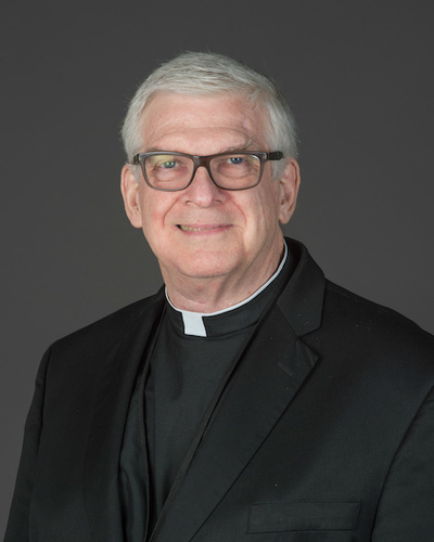 Rev. Stephen P. Newton, C.S.C.