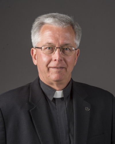 Rev. Michael E. Connors, C.S.C.